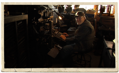 Alan Runfeldt sits at the keyboard of Barry Mueller's                  Intertype at The Excelsior Press